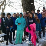 Students in the snow at Williamsburg trip