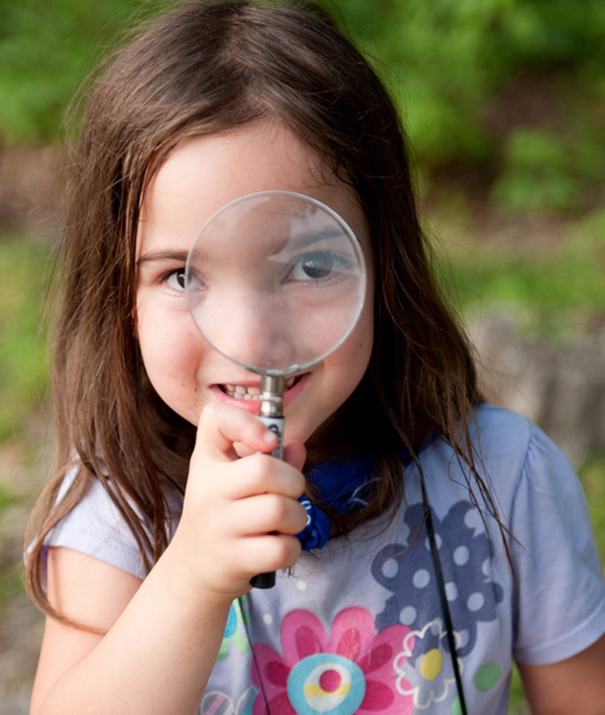Girl holding magnifying glass - come take a look