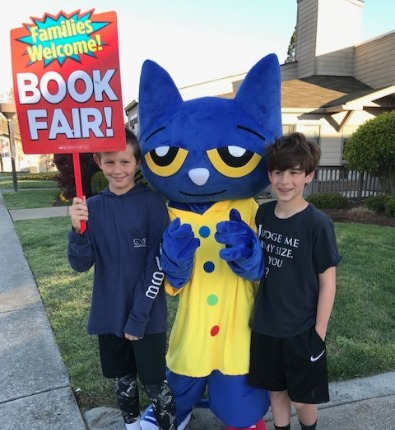 two boys with book fair Pete the cat