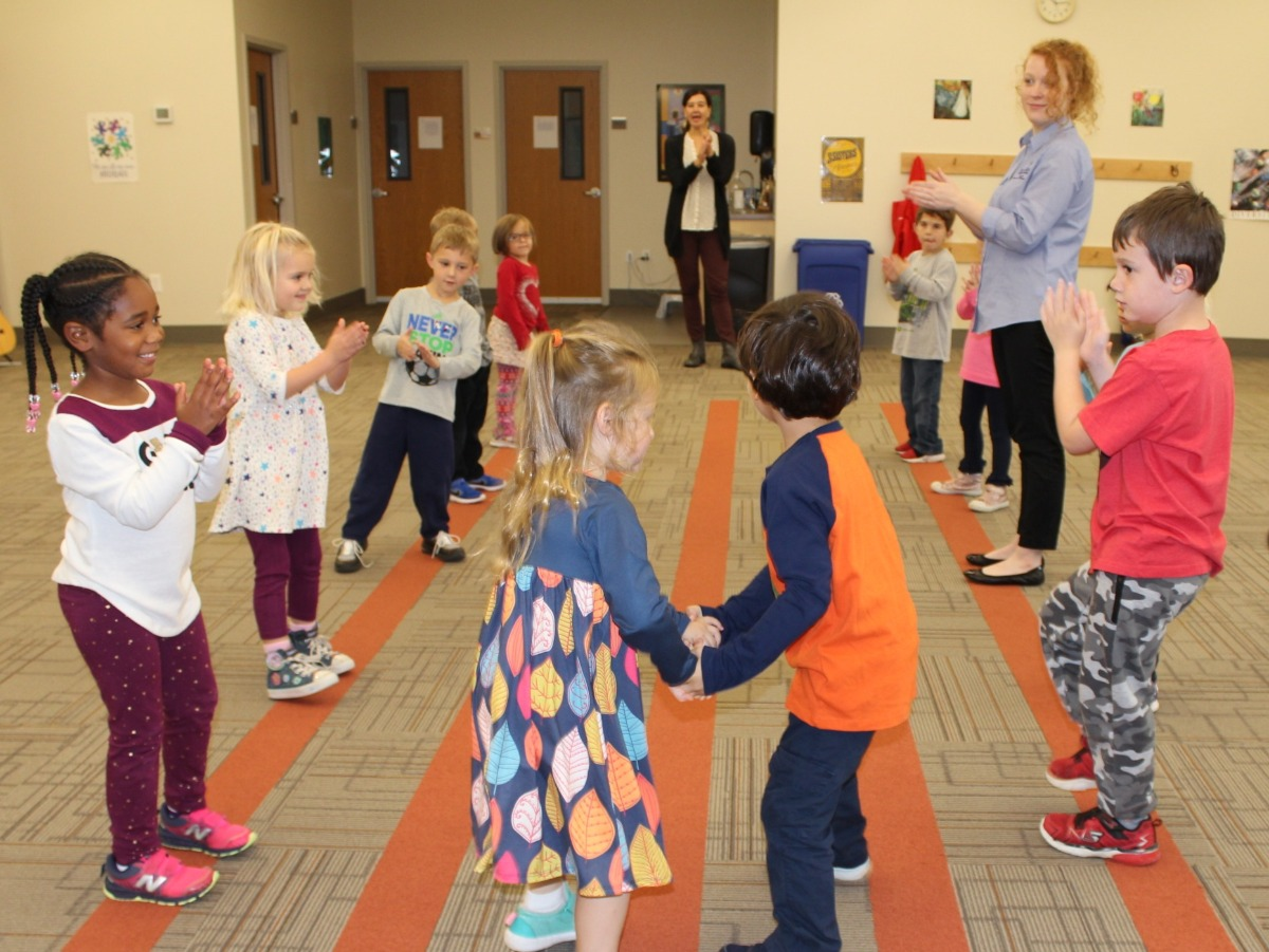 Young children dancing in music class