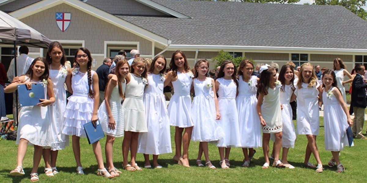 Row of girls outside after graduation