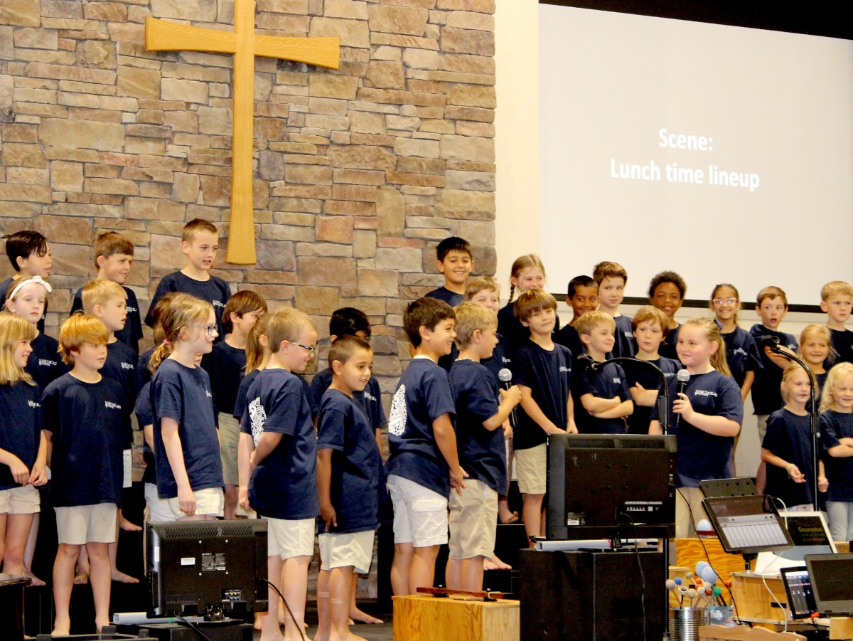 Lower Primary students singing and playing instruments for Chapel program